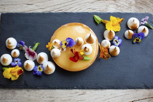 Tarte aux citron blow torch meringue with edible flower