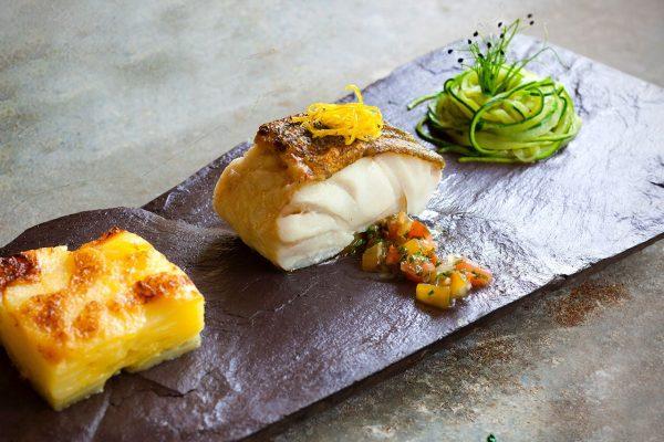 Pan fried cod fillet lemon confit, courgette spaghetti, tomato concasse & gratin Dauphinois